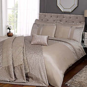 SPECIAL OFFER Save up to 50% on RRP. A classic and elegant design duvet set featuring a shiny panel with stylish pintuck detailing. Perfect for any bedroom. Duvet set consists of a duvet cover and pillowcase(s) one with single, two with double, king and super king.  Washable  Face: Microfibre  Reverse: 50% Polyester 50% Cotton