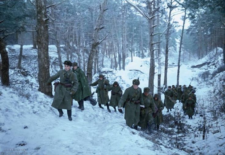 Soviet soldiers trudge through the snow in the forest near Zvenigorod, Moscow Oblast, Russia. (30km. west of Moscow)  1st of November 1941.  The Soviet defensive effort frustrated Germany's attack on the capital of the Soviet Union, and the largest Soviet city.  By Paul Reynolds