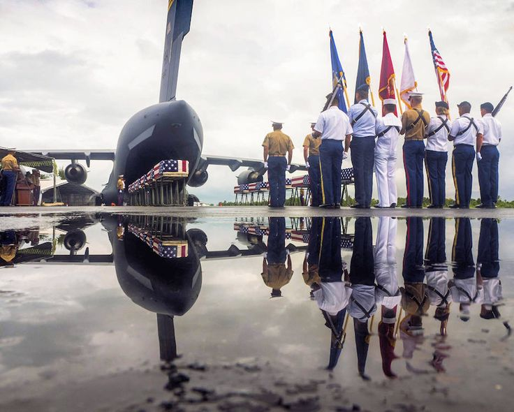 Members of the Defense POW/MIA Accounting Agency conclude a repatriation ceremony in Kiribati, Tarawa for fallen service members missing from the World War II battle of Tarawa.