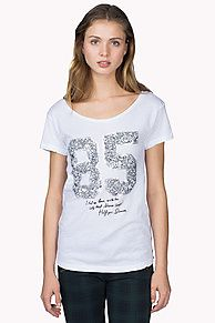Soft and light jersey tee with a sequined '85' and Hilfiger Denim signature on the chest. Flattering scoop neck with signature tape along the neckline. Short sleeves with Hilfiger Denim flag on the left. Straight styling with slightly rounded hem..<br/><br/>Our model is 1.76m and is wearing a size S Hilfiger Denim t-shirt.