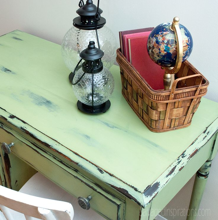 """Chippy Vaseline Distressed Desk Top """"Here's what I used. :: First Coat Miss Mustard Seed's Typewriter mixed with Bonding Agent :: Top Coat Miss Mustard Seed's Lucketts Green :: Vaseline or any brand of Petroleum Jelly will work :: A cheap Paint Brush"""""""