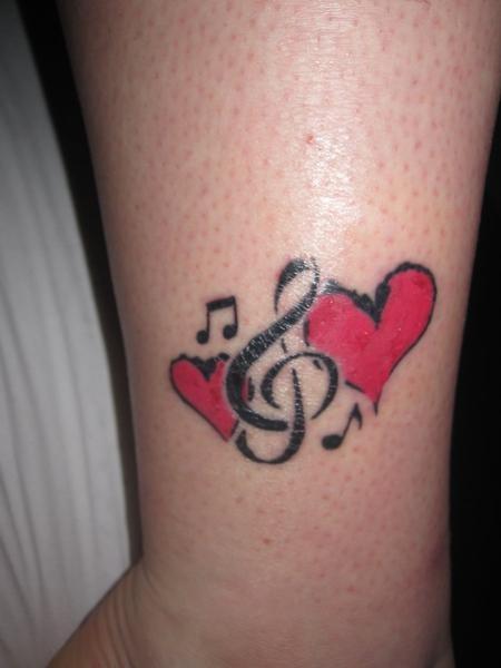 татуировки на ногах маленькие