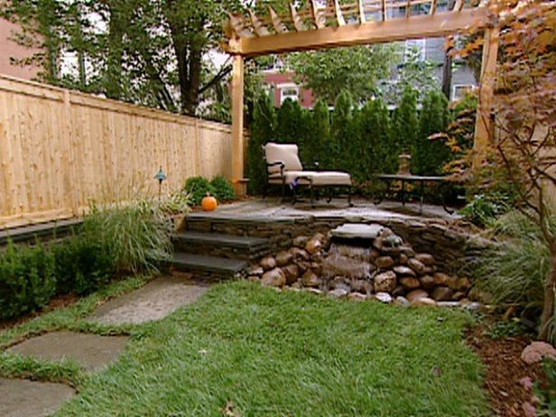 Small Patio | Small Yard Makeovers. A Stone Path Leads To An Elevated Stone  Patio. Patio IdeasLandscaping IdeasBackyard ...