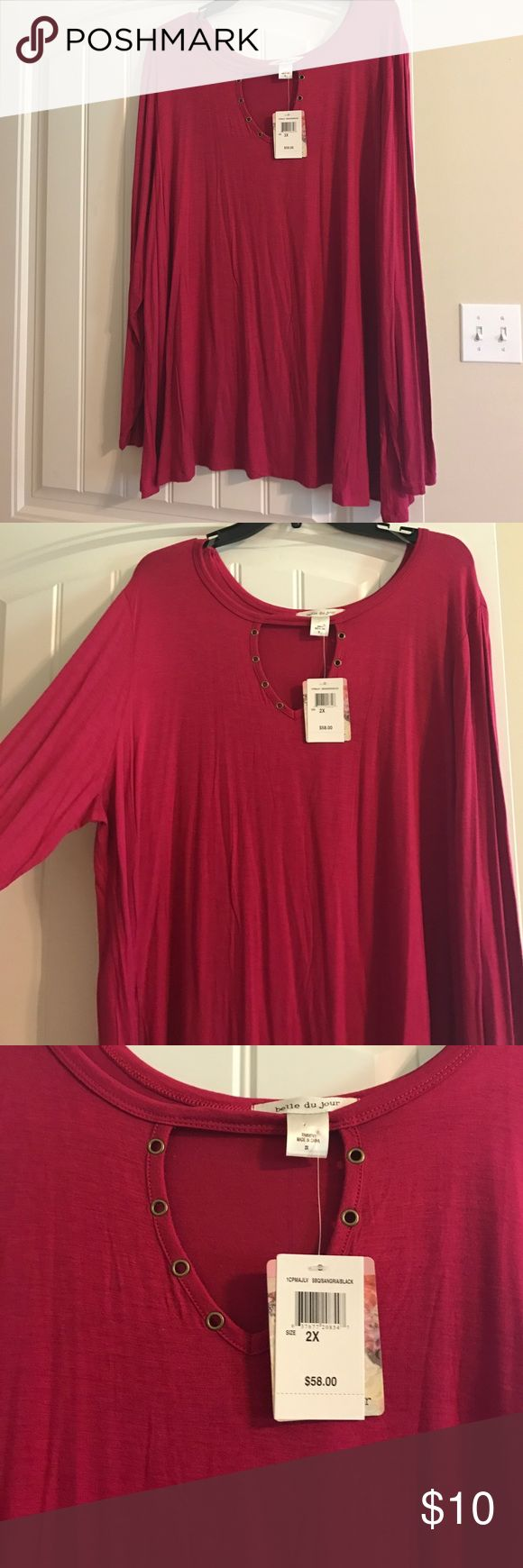NWT cute top Sangria color blouse . With key hole neck with bronze ring holes to embellish is . New with tags . Never worn Belle Du Jour Tops Blouses