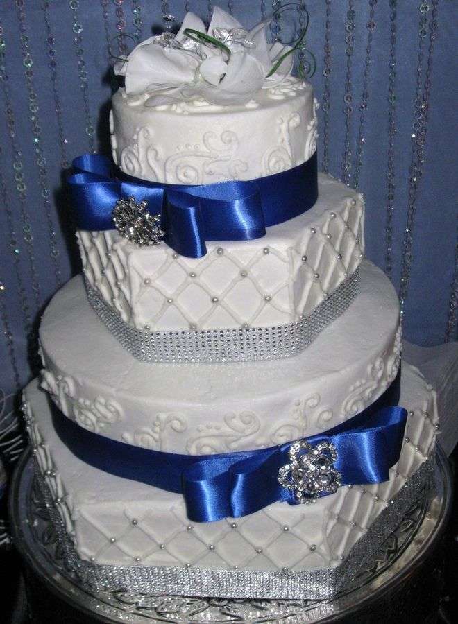Hexagon and round cakes with rhinestone accents and satin ribbon