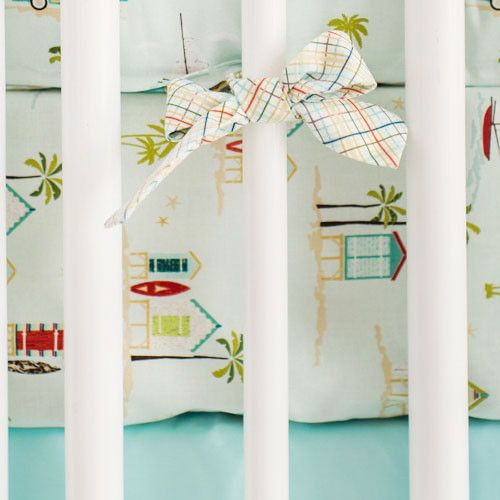 Bring the beach home with this tiki huts, surfboards and sail boats printed on premium 100% cotton. Crib Sheet Features: Crib sheets have elastic around all four corners and are fitted for a snug, sec