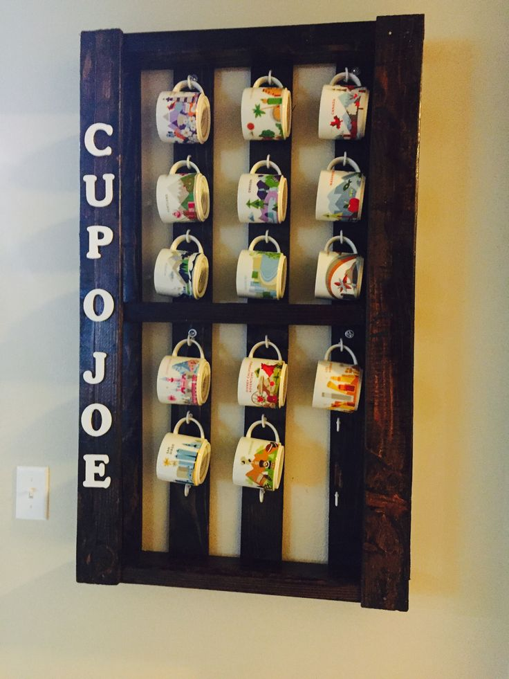 Palette coffee mug holder! Cut a palette across the center to better fit a narrower wall in our home. Close to the kitchen and displays our Starbucks mug collection!