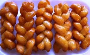 Koeksisters. a traditional sweet syrupy plait with a crunchy rich taste.