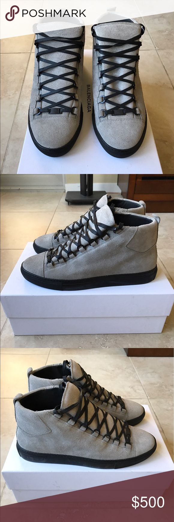 Balenciaga Arena High Grey / Black Authentic Balenciaga Arena High Sneakers in Gris Suede Leather. Purchased new from South Cost Plaza Balenciaga and in mint condition. These are fairly hard to come by and definitely attract attention/ admiration as this colorway is not seen worn often. Get it now for a fraction of retail price.   Size 43  100% Authentic Balenciaga Arena sneaker in Gris suede. This is the first time in several years that Balenciaga has released the Arena in suede. Don't miss…