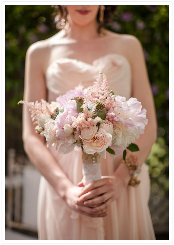 Beautiful, soft and romantic vintage style bouquet idea!  The lace around the stems and the soft colored flowers really create that romantic vintage look.  Photo by Danielle Capito Photography via 100 Layer Cake.