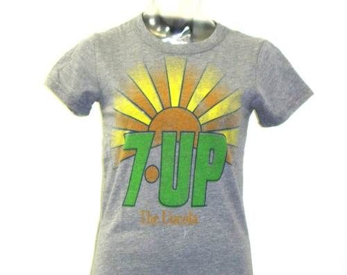 Vintage 7Up t-shirts by Junk Food Clothing are at Rocker Rags! Click now for women's tees with 7Up's 1970s logo and The Uncola slogan. Free Shipping!