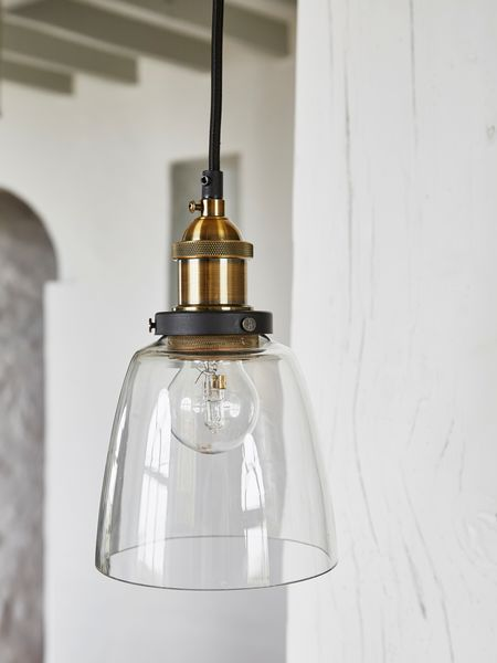 Installing beautiful lighting is an instant way to usher a timeless atmosphere into your home, and these elegant glass pendants do so to perfection.