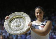 FILE - In this July 6, 2013, file photo, Marion Bartoli, 28, of France, smiles as she holds the trophy after winning the women's singles final against Sabine Lisicki, of Germany, at the All England Lawn Tennis Championships in Wimbledon, London. With her body aching after another loss at the Western & Southern Open in Masion, Ohio, Bartoli decided to retire from tennis Wednesday night, Aug. 14, 2013, saying she could no longer deal with the continuous pain on the court.