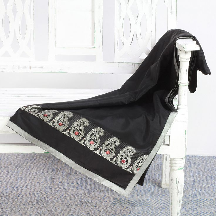 Alluring paisley motifs in pearl grey dance across a black body on this soft throw blanket from India. Handwoven from 100% silk on the jacquard loom, the throw is presented by fashion designer Parul Bajoria, working in the time-honored Baluchari style.