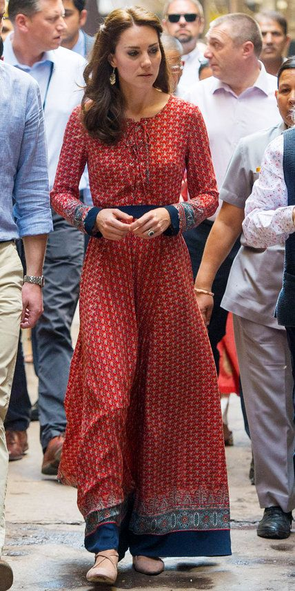 The Duchess wowed in a printed red maxi dress during her trip to India, topping off her look with an atypical choice of footwear—chic criss-cross nude ballet flats.