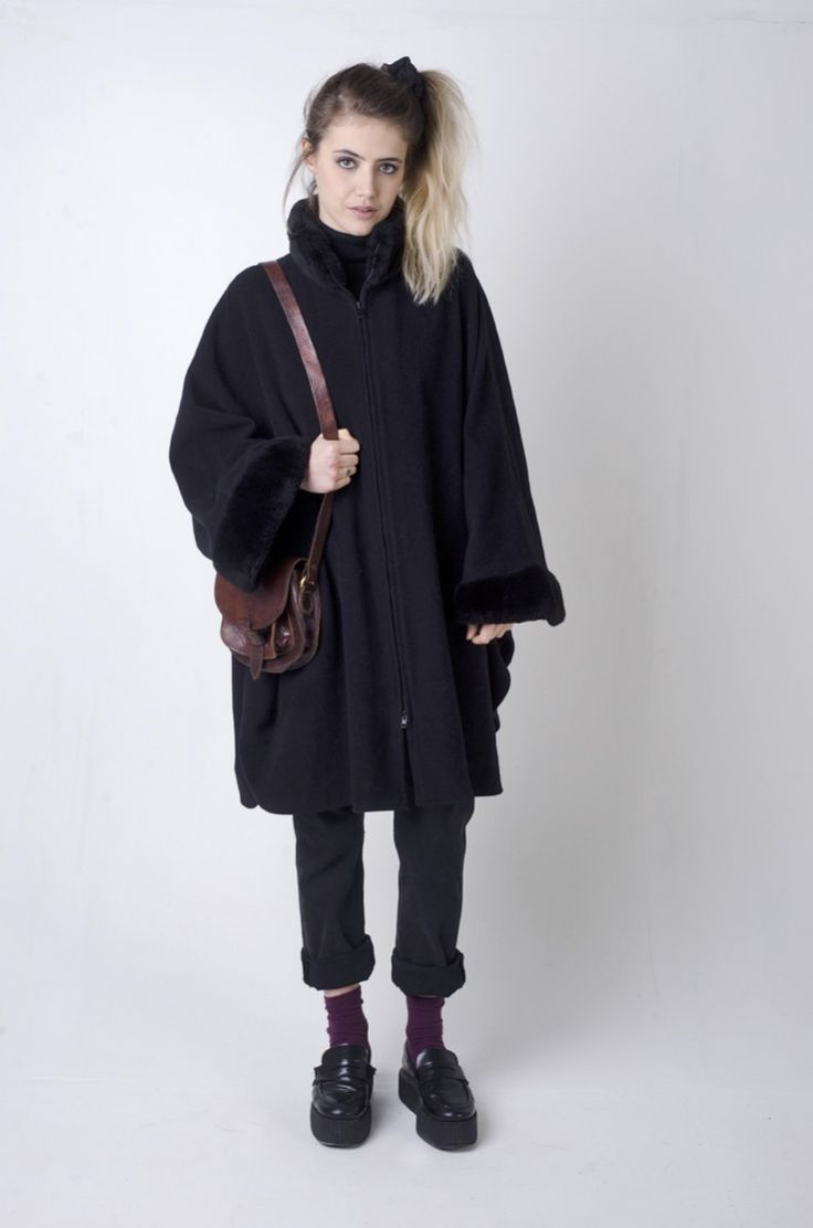 Is it a cape? Is it a coat? IT'S BOTH! Can you believe it? Available on the Nordic Poetry Website Of Course http://www.nordicpoetry.co.uk/retro-black-faux-fur-cape-coat