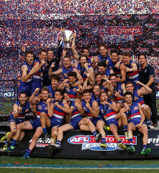 The Bulldogs celebrate after winning the 2016 Toyota AFL Grand Final match between the Sydney Swans and the Western Bulldogs at the Melbourne Cricket...