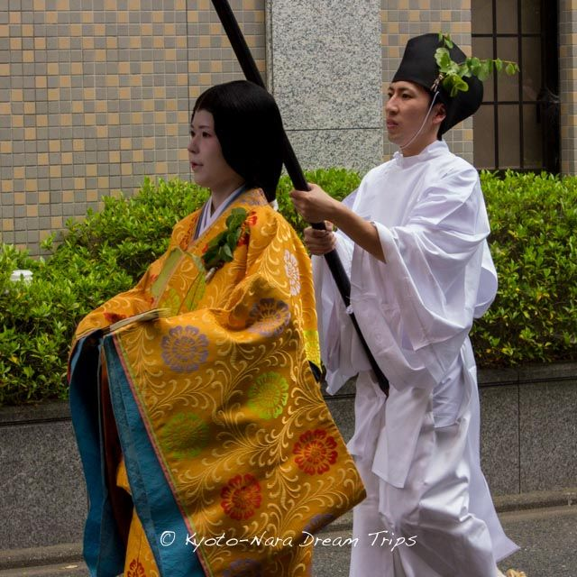 What beautiful brocade: the entourage of the Saiō-Dai Princess during the Aoi Matsuri (葵祭) in Kyoto. In the Heian period these ladies (myōbu) were of the court/noblewomen of the mid or fifth rank.