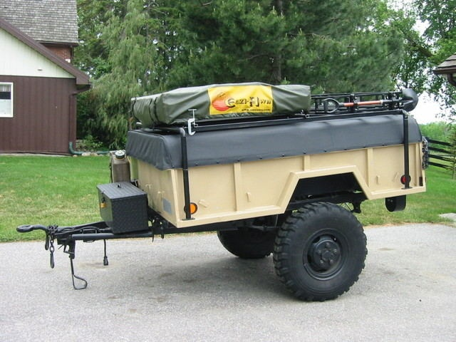 Off road trailer with roof top tent, gas, supplies, etc.