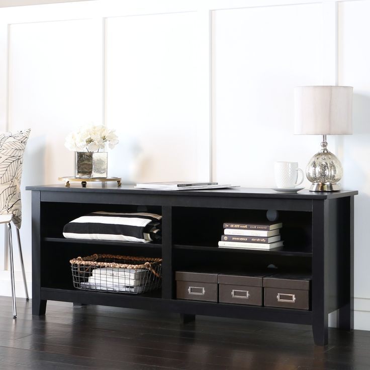 Display your TV in style with this 58 inch wood media stand. Features adjustable shelving to fit your media components and accessories with a cable management system to help maintain a tidy entertaining space.