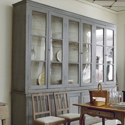 glass front cupboard... white or a rustic mahogany finish would be nice, but not too polished
