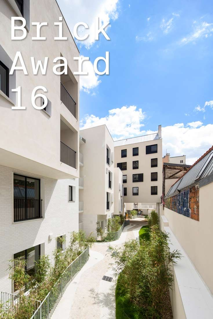 """#WienerbergerBrickAward 2016 nominee 12: Belleville housing project, France by Antonini Darmon Architecte, France. The façades of the five """"small"""" houses and the existing building are given a matt white plaster finish, which rest on a base covered with shiny white enamelled bricks, a reminder of the neighbourhood's past. Photographer: Julien Lanoo"""