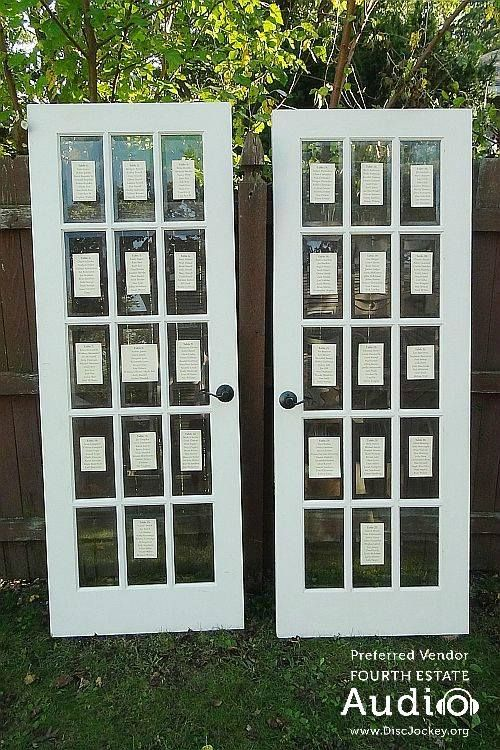 Two vintage glass double doors held the evening's seating chart. http://www.discjockey.org/real-chicago-wedding-sept-26-2015