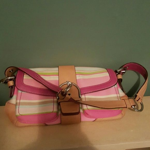 Multi colored striped Coach purse Multi colored striped Coach purse. Perfect for spring. Lots of pockets. Authentic Coach. Has some stains and blemishes but color and cuteness of bag overshadow them. Ask me questions if you have any. Make me a reasonable offer. Coach Bags Shoulder Bags