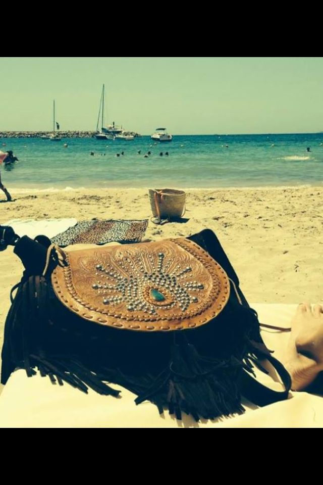 DEUS PEACOCK BAG holidaying in Mallorca Spain! Jodilee Winter 14. Hand-carved peacock design featuring silver studs and turquoise stone. www.jodilee.com.au Facebook Jodilee Instagram jodileedesigns