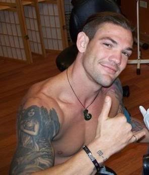 Leland Chapman is wearing fish hook carved from buffalo horn