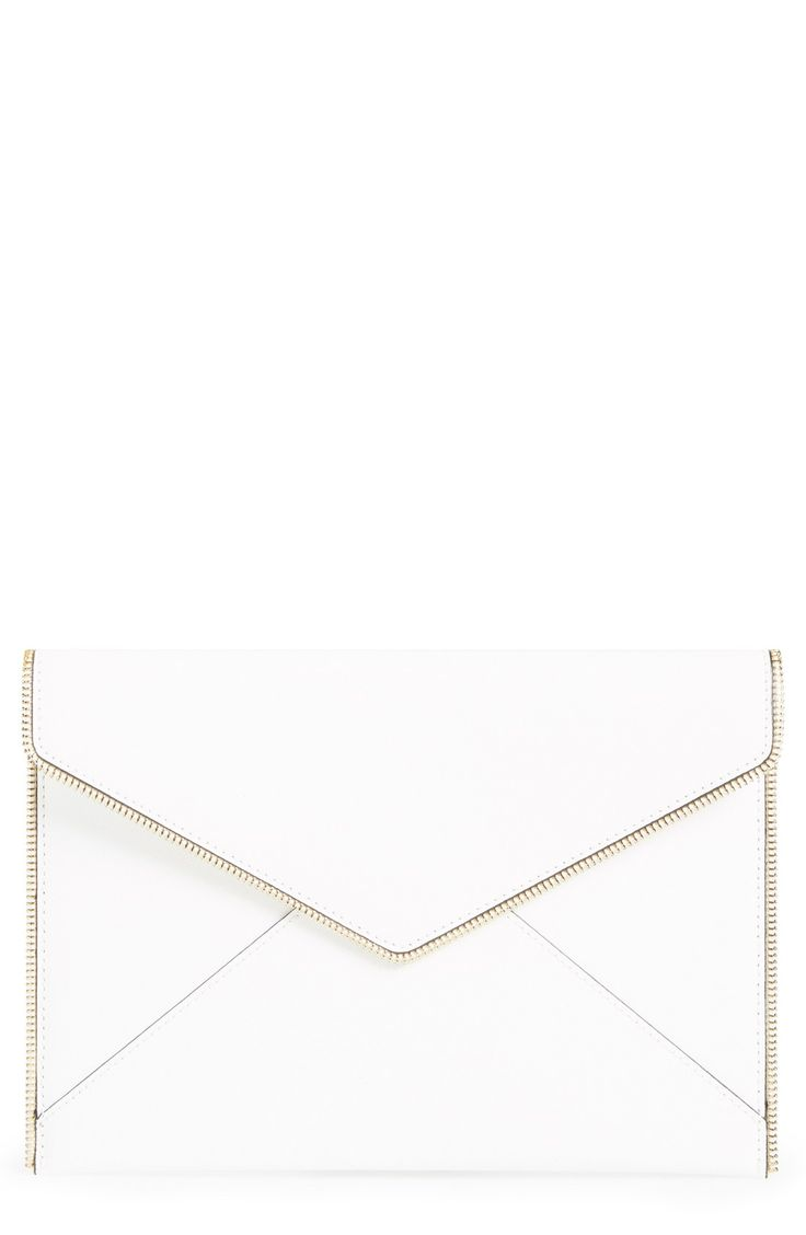 New favorite from Rebecca Minkoff! Open zip teeth trace the edges of a slim envelope-flap clutch crafted from scratch-resistant Saffiano leather.