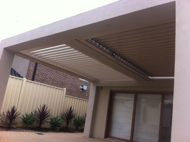 A rendered louver project including two bays which allows flexibility to open one or both plus lights in middle of verandah