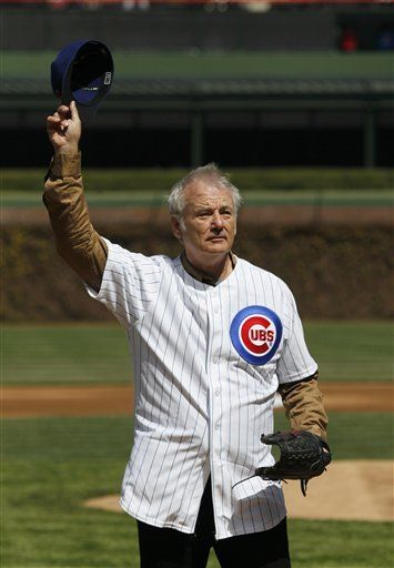 Actor Bill Murray waves to the crowd before throwing out a ceremonial first pitch before a opening day baseball game between the Chicago Cubs and the Washington Nationals Thursday, April 5, 2012, in Chicago. The Nationals won 2-1.
