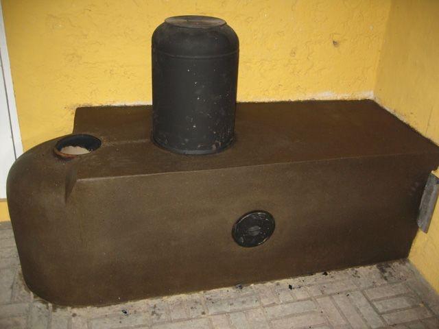 Rocket mass heater raketovne wood burning stoves for Small rocket heater