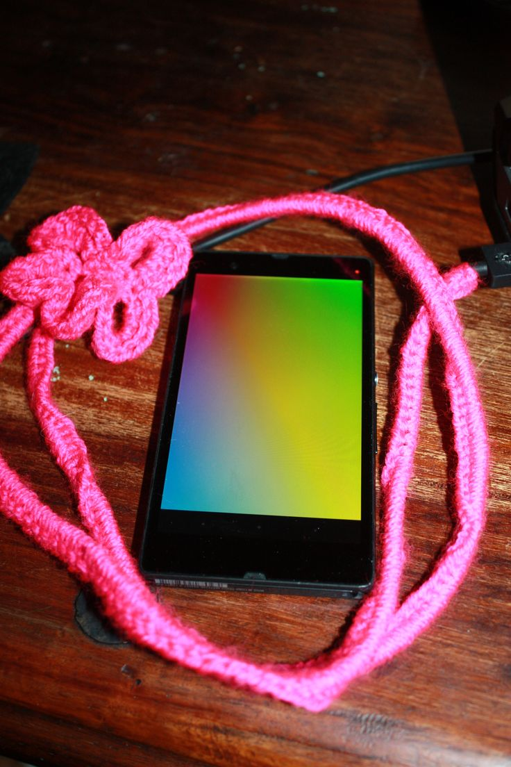 Cell phone charger crochet flower