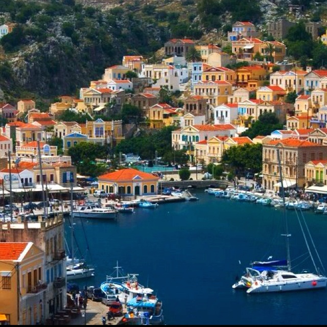 Simi - the most beautiful harbour in Greece.I wish I were there again! One day Simi one day!!!