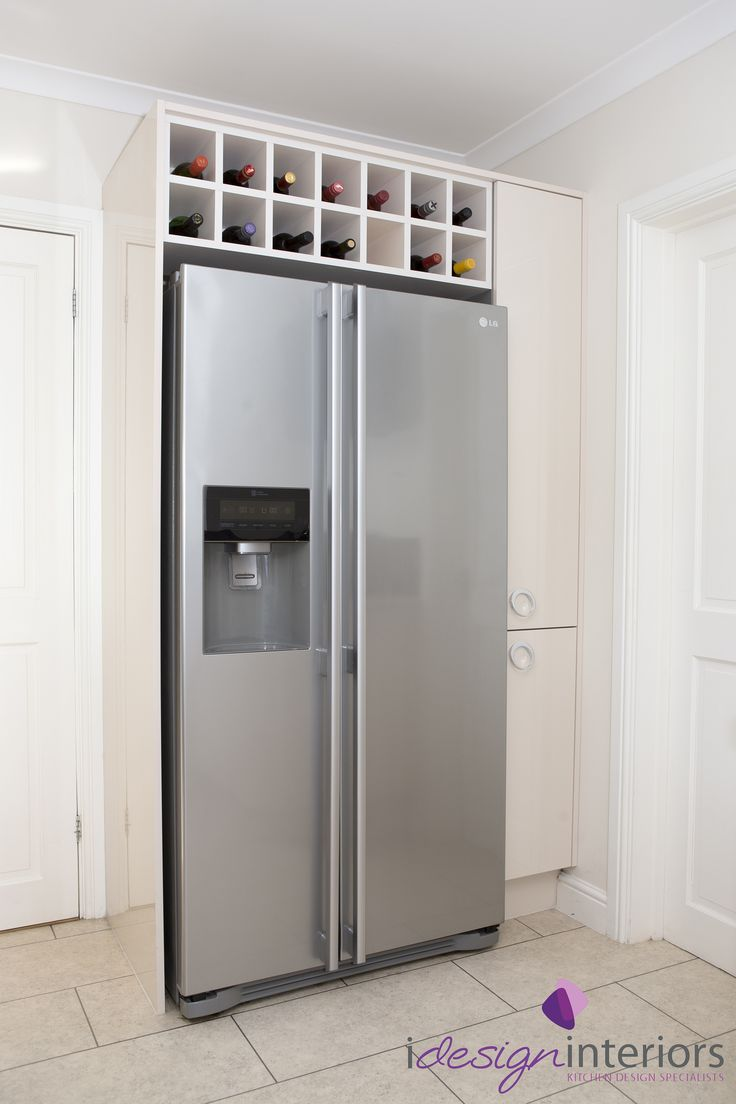American style fridge freezer with surrounding gloss cream units in kitchen by Idesign Interiors