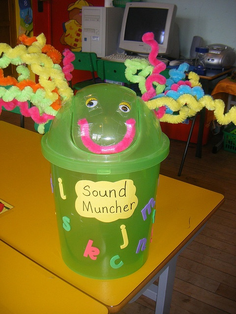 "Sound Muncher:  Put pictures/flashcards inside when teaching a new letter, for the kids to pull out. Put 3D letters into him and the kids have to put their hands in and guess what letter they can feel or ""feed"" him pictures of words beginning with a particular letter. He has so many uses!"