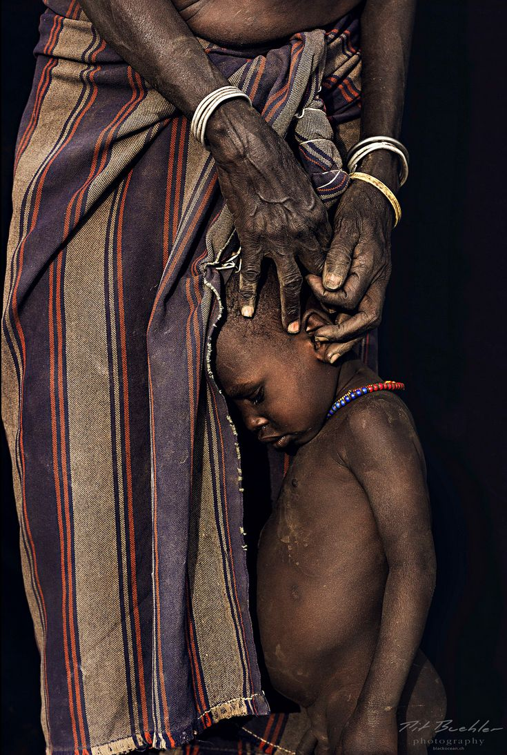 Child from Dassanech tribe with grandmother, Omo Valley, Ethiopia by Pit Buehler from series 'African Vogue', October 2013.