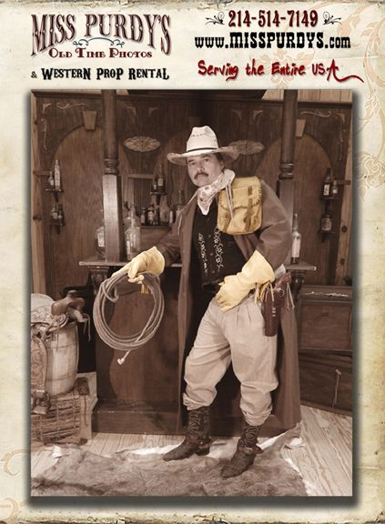 """The Cowboy"" Old Time Photo Booth for rent in Fresno CA with complete mobile service to the entire USA, complete with Saloon Backdrop, western Costumes, Ropes, Saddle Bags, Gauntlets, Gloves, Duster jackets, Accessories, Hats, Dusters, Pistols, Long Guns, Swords, & photo props!"