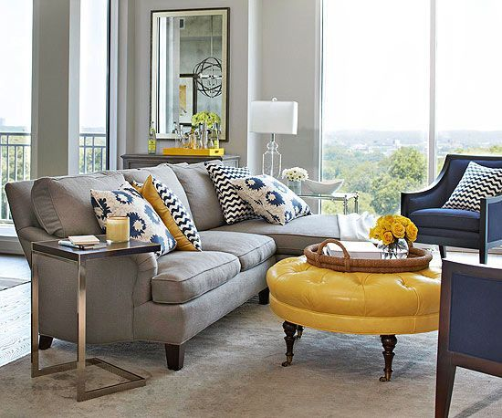 Patterned pillows add fresh style to this condo living room. See the rest of this modern condo: http://www.bhg.com/decorating/small-spaces/apartments/modern-condo/?socsrc=bhgpin051813navyyellowcondo=2