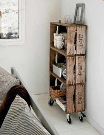 crate shelf with rollers. What if you turned them on their sides (still with casters) and made them side tables?