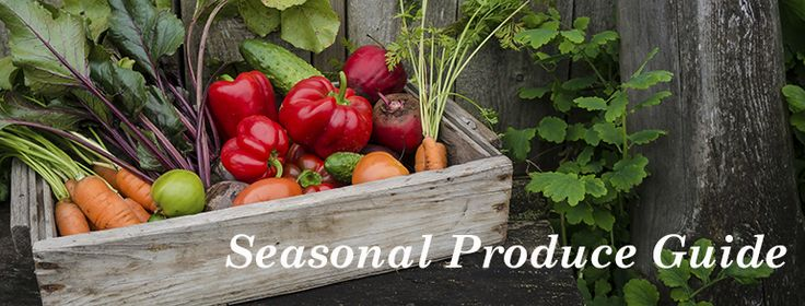 box of colorful vegetables in a rustic setting with text seasonal produce guide