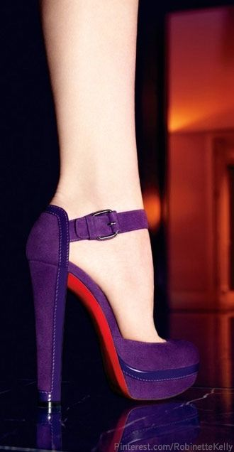 "Christian Louboutin ""Lux"" ankle-strap platform pumps in ultra-violet suede and patent leather. Also available in red. 5½"" heel. Sizes 5–12. Italy. $945."
