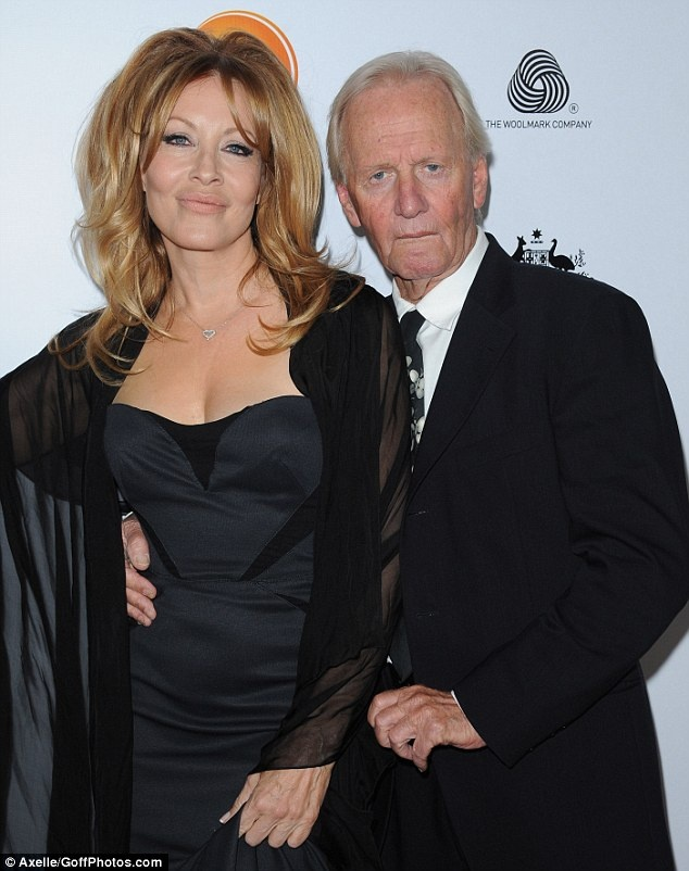 She's 54. Please let me look halfway as good when I'm that age!!!   Still smitten: Crocodile Dundee stars Paul Hogan and Linda Kozlowski prove that they're still going strong after 23 years of marriage, as they hit the red carpet on Saturday night