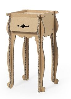 There are some cute examples of cardboard furniture for home and display on my friend Deb Dusenberry's blog Curious Sofa.