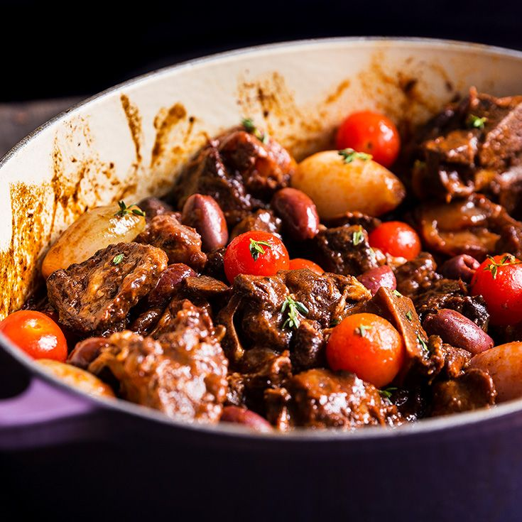 Lamb is braised in red wine before getting tossed with olives and tomatoes in this recipe from Houston chef Chris Shepherd's new restaurant, One Fifth.
