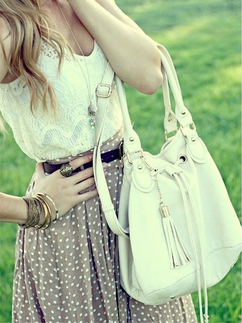 Shirt skirt combo with necklace.