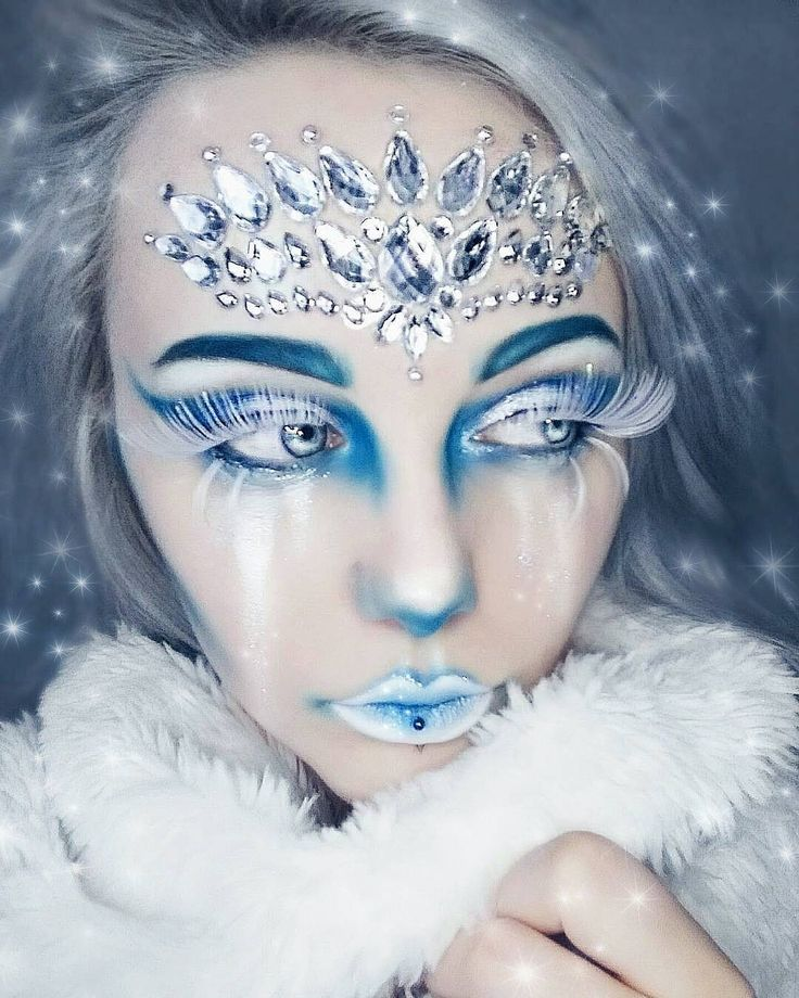 """Face gems by Funkon We are like snowflakes! All different in our own beautiful way..❄️❄️❄️❄️ The incredible @arteviscu is wearing our FunkOn one piece """"TEMPTRESS"""" face gem!!! #funkon"""