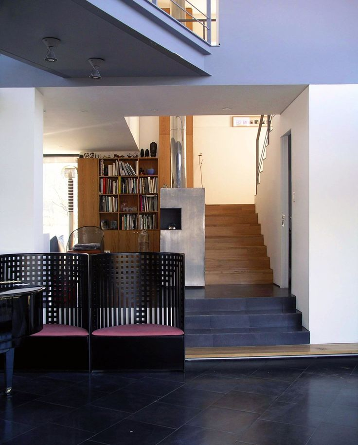 View of the stairway leading up to the second floor from the atrium.  http://www.hjlstudio.com/suip-777-residence